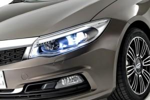 Qoros-3-Sedan-detail-front-qtr-lights-on-450x300