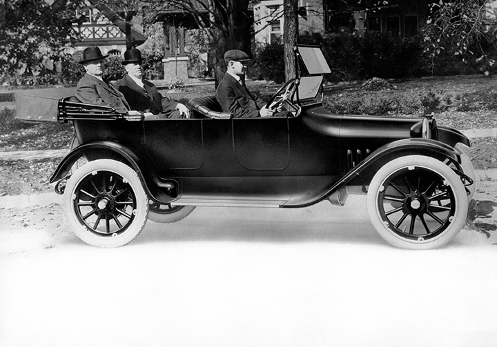Horace Dodge (left rear) and John Dodge (right rear) take delive