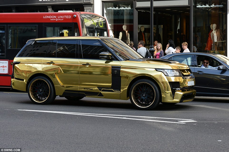 1407229980677_Image_galleryImage_Gold_Range_Rover_which_ha