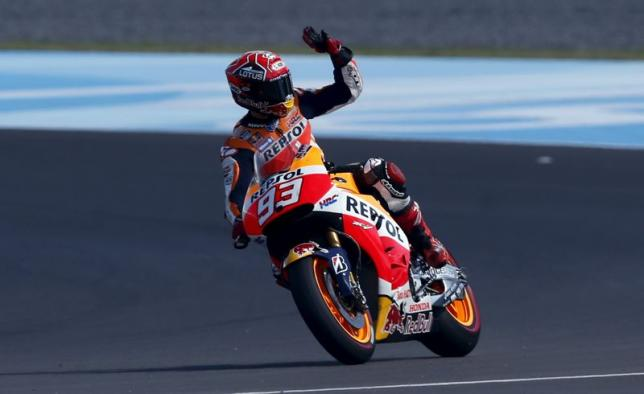Honda MotoGP rider Marquez of Spain waves to fans as he celebrates his pole position after the qualifying session at Argentina's MotoGP Grand Prix at the Termas de Rio Hondo International circuit in Termas de Rio Hondo